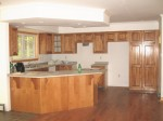 Kitchen with Pantry, Dropped Ceiling, and Angled Peninsula