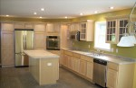 Natural Maple Kitchen with Island, Cooktop, Wall Oven, Recessed Lights, and Dual Pantries